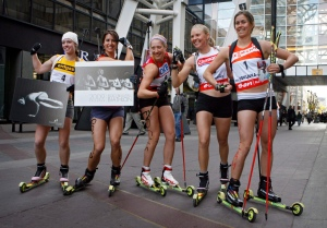 With her fellow biathletes on October 22, 2008 selling the Bold, Beautiful Biathlon Calendar in Calgary. Image obtained from: http://olympic.ca/2013/07/02/why-funding-is-worth-the-fight/ THE CANADIAN PRESS/Jeff McIntosh